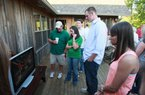 Former Arkansas quarterback Ryan Mallett (second from right) watches the NFL Draft preview show at a hunting lodge near Stuttgart on Thursday.
