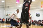 Arkansas Democrat-Gazette/fSTATON BREIDENTHAL --4/27/12-- Arkansas Hawks Tre Thompson shoots in front of DC Assault's Ahmad Fields during the Real Deal in the Rock tournament.