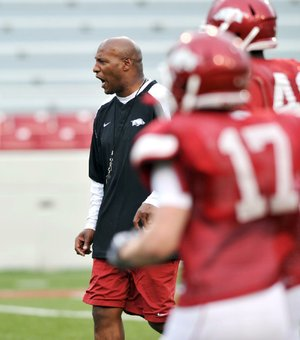 New defensive schemes from Arkansas defensive coordinator Paul Haynes (above) have kept the Hogs' offense on its toes.