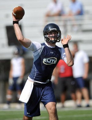 Charleston junior quarterback Ty Storey visited Arkansas Friday afternoon.