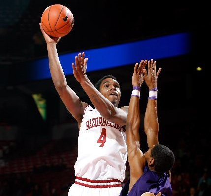 NWA Media/JASON IVESTER -- Arkansas junior Coty Clarke attempts a hook shot over LeMoyne-Owen junior Victor Shell during the first half on Monday, Nov. 5, 2012, at Bud Walton Arena in Fayetteville.