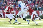 University of Arkansas linebacker A.J. Turner (left) and Tevin Mitchell put the stop on Tulsa receiver Keyarris Garrett during Saturdays homecoming game at Razorback Stadium.