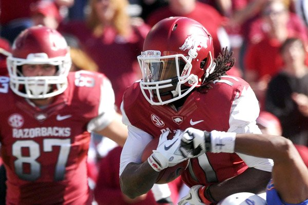 Arkansas wide receiver Cobi Hamilton (left) already has caught a school-record 69 passes this season and has now set his sights on a new yardage record for the Razorbacks with three games left.