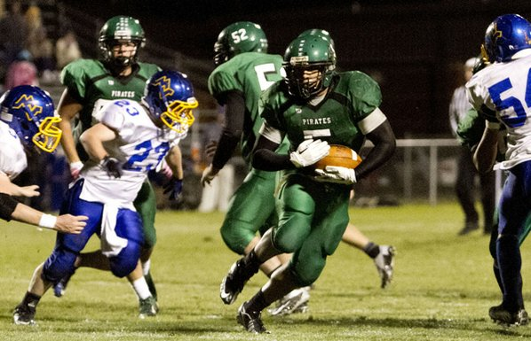 Greenland's Calvin Giddens, center, runs ...