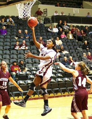 UALR forward Janette Merriex goes up for a shot between two Missouri State defenders during the first half of the Trojans' 78-68 loss to the Bears on Thursday at the Jack Stephens Center in Little Rock.