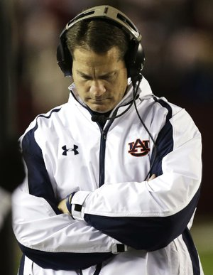 Auburn Coach Gene Chizik walks the sidelines during the second half of Saturday's 49-0 loss to Alabama at Bryant-Denny Stadium in Tuscaloosa, Ala. Chizik was fired Sunday after a 3-9 season by Athletic Director Jay Jacobs.