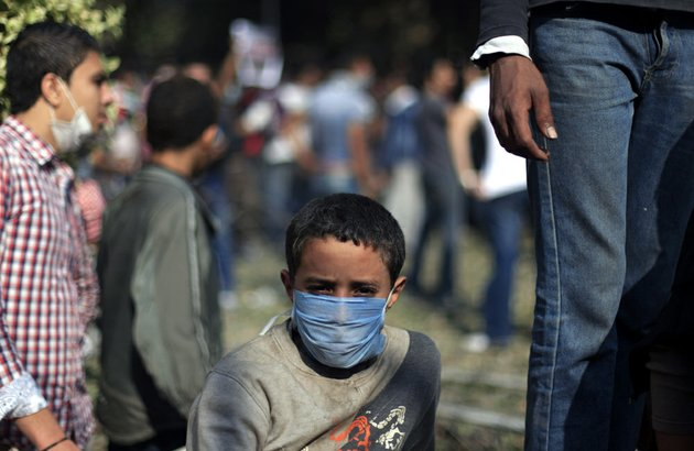 an-egyptian-boy-wears-a-mask-during-clashes-security-forces-near-tahrir-square-where-an-opposition-rally-has-been-called-for-to-voice-rejection-of-president-mohammed-morsis-seizure-of-near-absolute-powers-in-cairo-on-tuesday-nov-27-2012
