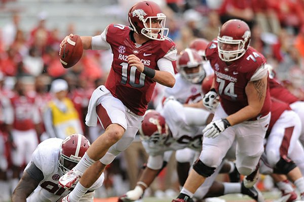 STAFF PHOTO ANDY SHUPE -- Arkansas quarterback Brandon Allen is tripped up by Alabama defensive lineman Quinton Dial during the fourth quarter of play Saturday, Sept. 15, 2012, at Razorback Stadium in Fayetteville.