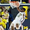 Michigan guard Tim Hardaway Jr., (10) dunks the ball in the first half of an NCAA college basketball...