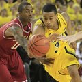 Arkansas guard BJ Young (11) reaches in and fouls Michigan guard Trey Burke (3)during the second hal...