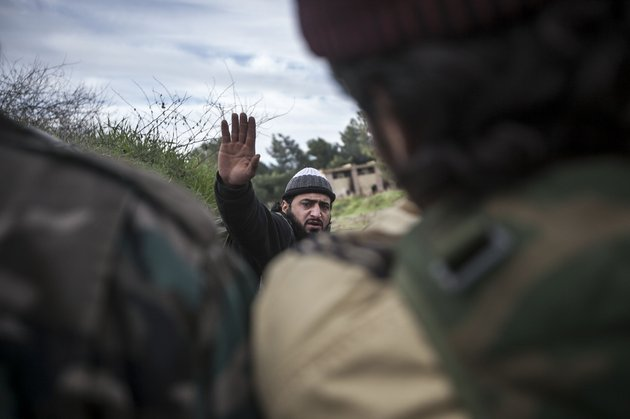in-this-saturday-dec-15-2012-photo-a-free-syrian-army-fighter-leads-his-comrades-during-heavy-clashes-with-government-forces-at-a-military-academy-besieged-by-the-rebels-north-of-aleppo-syria-free-syrian-army-fighters-took-control-over-the-military-academy-after-battling-government-forces-for-several-hours