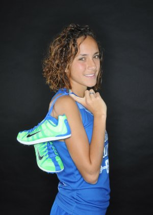 Maggie Montoya of Rogers is the NWA Media All-Big 7 Girls Runner of the Year.