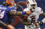 Louisville quarterback Teddy Bridgewater (5) is sacked by Florida linebacker Lerentee McCray (34) in the first half of the Sugar Bowl NCAA college football game Wednesday, Jan. 2, 2013, in New Orleans. (AP Photo/Butch Dill)