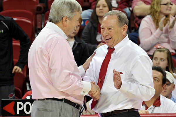 """It's a grind in the SEC,"" Arkansas women's Coach Tom Collen (right, shown with Texas A&M Coach Gary Blair) said Monday at the Downtown Tip-Off Club."