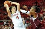 NWA Media/MICHAEL WOODS --01/06/2013-- Arkansas forward Sarah Watkins tries to get past Texas A&M defender Cierra Windham during Sunday afternoon's game at Bud Walton Arena in Fayetteville.