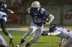 Arkansas Democrat-Gazette/STEPHEN B. THORNTON -- North Little Rock's Altee Tenpenny runs through Fayetteville defenders during their Class 7A playoff football game Nov. 23, 2012 in North Little Rock.