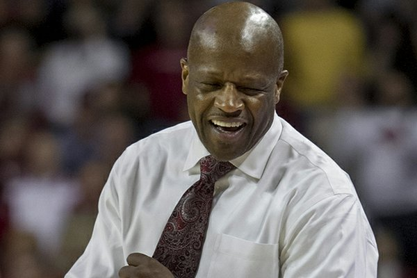 Arkansas head coach Mike Anderson celebrates at the end of the second overtime an NCAA college basketball game against Auburn in Fayetteville, Ark., Wednesday, Jan. 16, 2013. Arkansas defeated Auburn 88-80. (AP Photo/Gareth Patterson)