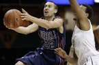 Mississippi guard Marshall Henderson (22) drives past Vanderbilt guard Kevin Bright, right, in the first half of an NCAA college basketball game on Tuesday, Jan. 15, 2013, in Nashville, Tenn. (AP Photo/Mark Humphrey)