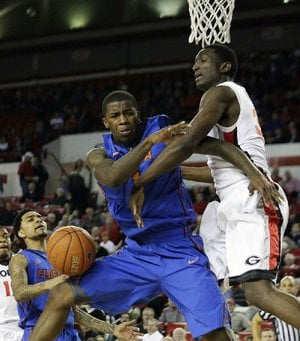 Florida guard Kenny Boynton (1) is fouled by Georgia forward Brandon Morris (right) as he drives to the basket during the second half of the No. 8 Gators' 64-47 victory over the Bulldogs on Wednesday in Athens, Ga.