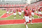 STAFF PHOTO ANDY SHUPE -- Arkansas running back Knile Davis (7) walks off the field after the Razorbacks' 52-0 loss to Alabama Saturday, Sept. 15, 2012, at Razorback Stadium in Fayetteville.