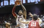 Alabama guard Trevor Lacey (5) takes a leaping shot during an NCAA college basketball game against Arkansas, Thursday, Jan. 31, 2013, in Tuscaloosa, Ala. Alabama won 59-56. (AP Photo/Alabama Media Group, Vasha Hunt)