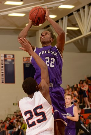 Trey Boyd of Fayetteville shoots over Rogers Heritage's Xavier Thomas on Friday in Rogers