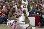 Arkansas' BJ Young (11) prepares to spin to the hoop during the first half an NCAA college basketball game against Tennessee in Fayetteville, Ark., Saturday, Feb. 2, 2013. Arkansas defeated Tennessee 73-60. (AP Photo/Gareth Patterson)