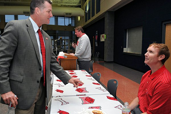 Sean Rochelle (left), pictured in this 2009 file photo with former Arkansas basketball coach John Pelphrey, has worked with the Razorback Foundation since 2008.