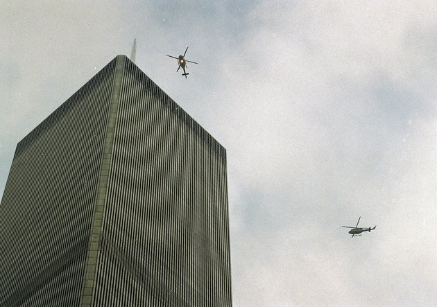 in-this-file-photo-of-feb-26-1993-helicopters-jockey-for-position-over-the-world-trade-center-in-new-york-following-a-noontime-blast-which-rocked-the-twin-towers-complex