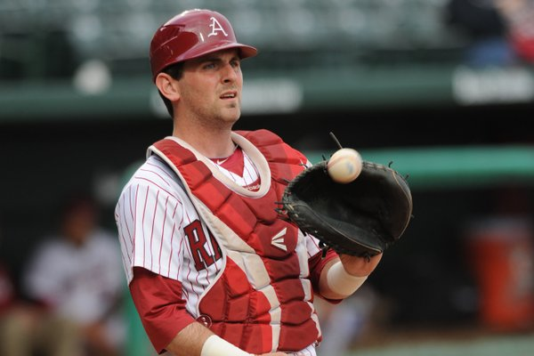 Arkansas catcher Jake Wise warms up Saturday, April 20, 2013, before the start of play against Texas A&M at Baum Stadium in Fayetteville.