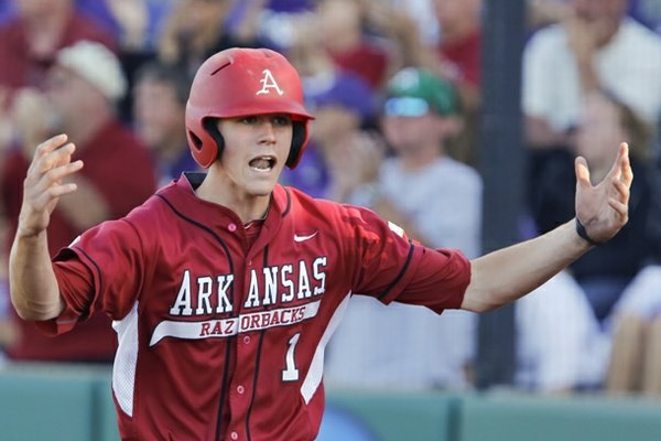 Arkansas' Brian Anderson celebrates after scoring a run against Kansas State in the first inning in an NCAA baseball regional game in Manhattan, Kan., Sunday, June 2, 2013. (AP Photo/Jeff Tuttle)
