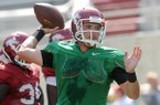 Arkansas quarterback Brandon Allen warms up prior to a 2013 practice at Razorback Stadium in Fayetteville.