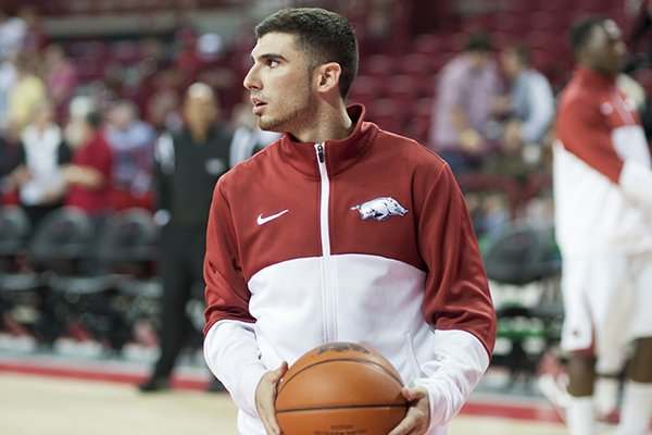 Arkansas' Kikko Haydar warms up before an NCAA college basketball game in Fayetteville, Ark., Tuesday, Dec. 3, 2013. (AP Photo/Sarah Bentham)