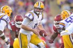 LSU quarterback Zach Mettenberger looks to hand off the ball in the third quarter of Friday afternoon's game at Tiger Stadium in Baton Rouge, La.
