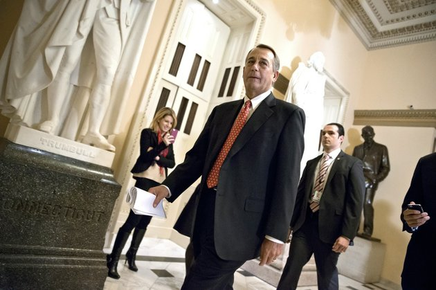 speaker-of-the-house-john-boehner-r-ohio-walks-to-the-chamber-thursday-evening-dec-12-2013-as-the-house-holds-final-votes-before-leaving-for-the-holiday-recess-at-the-capitol-in-washington