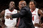 Arkansas coach Mike Anderson talks with Alandise Harris, left, and Michael Qualls during the second half of the game against UTSA in Bud Walton Arena in Fayetteville on Saturday January 4, 2013.