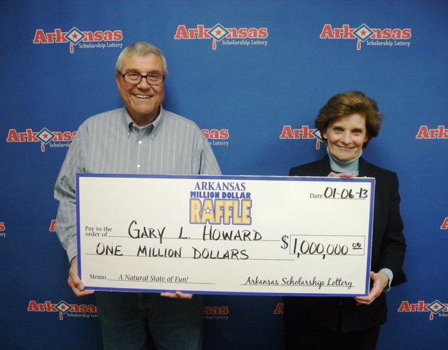 gary-and-nancy-howard-pose-with-a-check-for-1-million-after-claiming-the-winning-ticket-in-the-million-dollar-raffle
