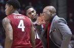 Arkansas coach Mike Anderson, right, reacts after a foul was called on Rashad Madden, center, during the first half of an NCAA college basketball game against Texas A&M in College Station, Texas, Wednesday, Jan. 8, 2014. (AP Photo/Bryan College Station Eagle, Stuart Villanueva)