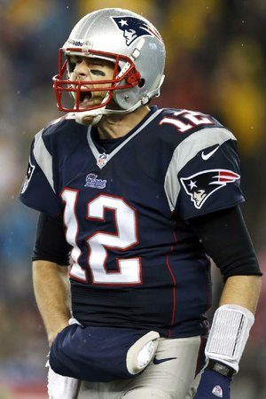 New England Patriots quarterback Tom Brady (12) yells during the second half of an AFC divisional NFL playoff football game against the Indianapolis Colts in Foxborough, Mass., Saturday, Jan. 11, 2014. (AP Photo/Michael Dwyer)