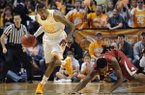 Tennessee guard Jordan McRae (52) beats Arkansas forward Coty Clarke (4) to a rebound during the first half of an NCAA college basketball game in Knoxville, Tenn., on Wednesday, Jan. 22, 2014. Tennessee won 81-74. (AP Photo/Knoxville News Sentinel, Adam Lau)