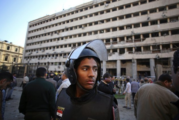 an-egyptian-policeman-stands-guard-after-a-car-bomb-attack-at-the-egyptian-police-headquarters-in-downtown-cairo-on-friday-jan-24-2014-three-bombings-hit-high-profile-areas-around-cairo-on-friday-including-a-suicide-car-bomber-who-struck-the-citys-police-headquarters-killing-several-people-in-the-first-major-attack-on-the-egyptian-capital-as-insurgents-step-up-a-campaign-of-violence-after-the-ouster-of-the-islamist-president