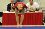 Arkansas gymnast Erin Freier performs on the bars during a Jan. 10, 2014 gymnastics meet at Barnhill Arena in Fayetteville.