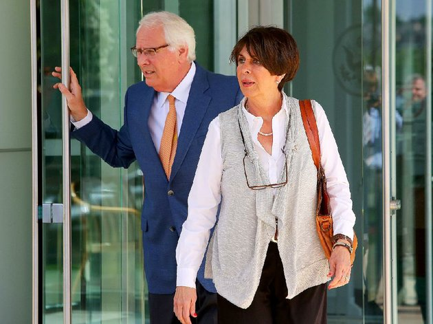 former-arkansas-treasurer-martha-shoffner-leaves-the-federal-courthouse-thursday-june-27-2013-in-little-rock-with-her-attorney-chuck-banks-after-pleading-not-guilty-to-14-federal-counts-of-extortion-and-bribery