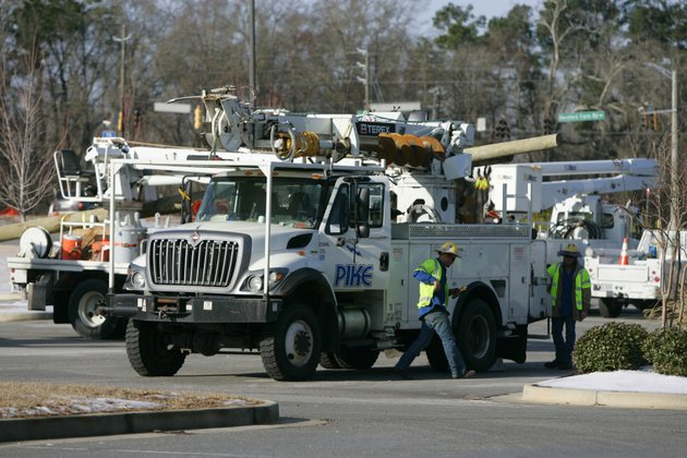 power-crews-assemble-at-a-grocery-store-that-was-close-due-to-the-power-outages-caused-by-an-ice-storm-this-week-friday-in-evans-ga-nearly-a-million-homes-and-businesses-in-georgia-lost-power-after-a-storm-blanketed-the-region-with-snow-and-ice-but-most-had-power-restored-by-friday-morning-georgia-utility-companies-said-a-total-of-989400-customers-lost-power-in-the-wake-of-this-weeks-storm-about-175000-customers-were-still-without-service-friday-morning