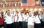 Members of the Arkansas track & field team celebrate their SEC championship Saturday in College Station, Texas.