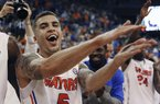 Florida guard Scottie Wilbekin (5) does the gator chomp after Florida defeated Auburn 71-66 during an NCAA college basketball game Wednesday Feb. 19, 2014 in Gainesville, Fla. (AP Photo/Phil Sandlin)
