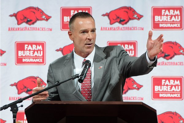 Jimmy Dykes speaks after being introduced as the eighth women's head basketball coach Sunday, March 30, 2014, at Bud Walton Arena in Fayetteville. Dykes left his job as an analyst for ESPN for the position. Dykes coached at Arkansas, Sacramento State, Appalachian State, Kentucky and Arkansas-Little Rock, and Oklahoma State.
