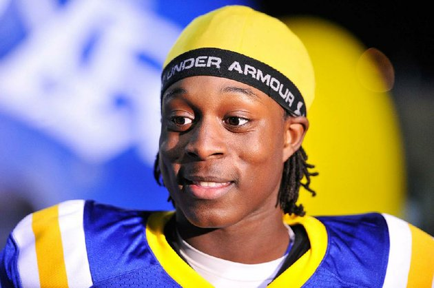 file-1182013-nlr-athlete-altee-tenpenny-talks-to-the-media-before-friday-nights-7a-quarter-final-game-in-north-little-rock