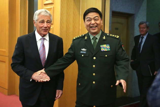 defense-secretary-chuck-hagel-shakes-hands-with-chinese-minister-of-defense-chang-wanquan-before-their-meeting-at-the-chinese-defense-ministry-headquarters-in-beijing-on-tuesday-april-8-2014