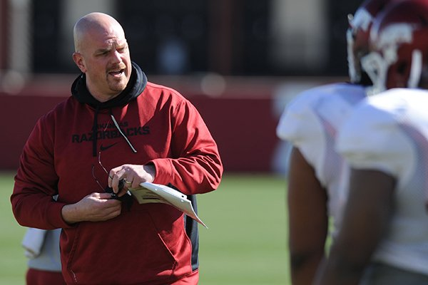 Arkansas defensive line coach Rory Segrest directs his players during practice Thursday, March 20, 2014, at the UA practice field in Fayetteville.